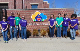 CAM Team volunteering at the FedEx Family House
