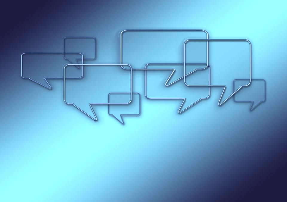 A group of speech bubbles representing communication