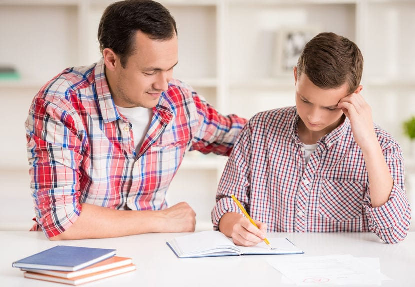 Father teaching son to learn language