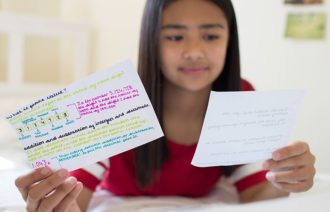 Girl Using revision cards